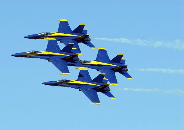 Image of four Blue Angel jets flying in formation on an angle